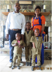 Mr. Mainimo Godlove and family, in our home