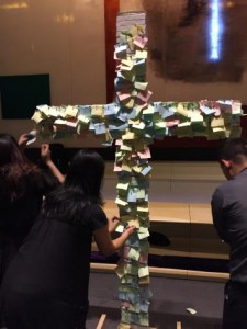 400+ attendees nailed their written transgressions on the cross at Good Friday service